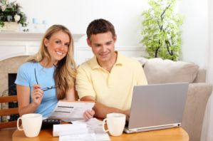 iS_14027868XSmall-smiling-couple-paying-bills.jpg